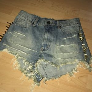 Gold spiked cut off jean shorts